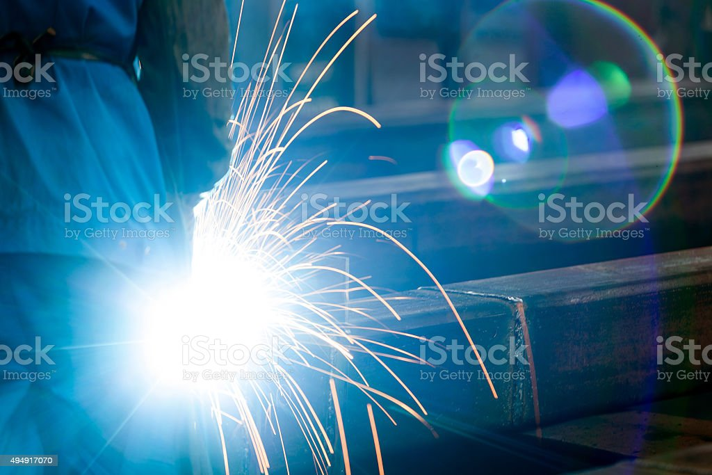Sparks from the cutting of steel produced stock photo