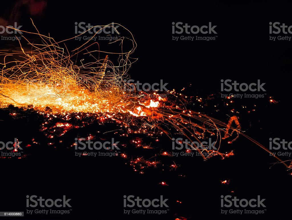 Sparks from the fire embers explosion on a black background stock photo