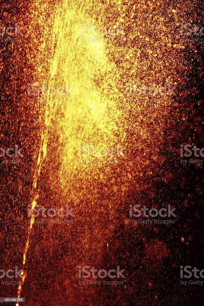 orange sparks on black background
