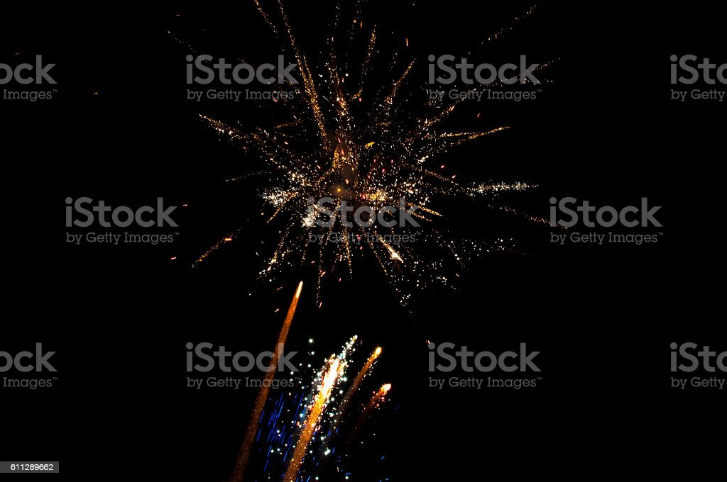 Outbreaks of fireworks in different colors and formyy in the night sky