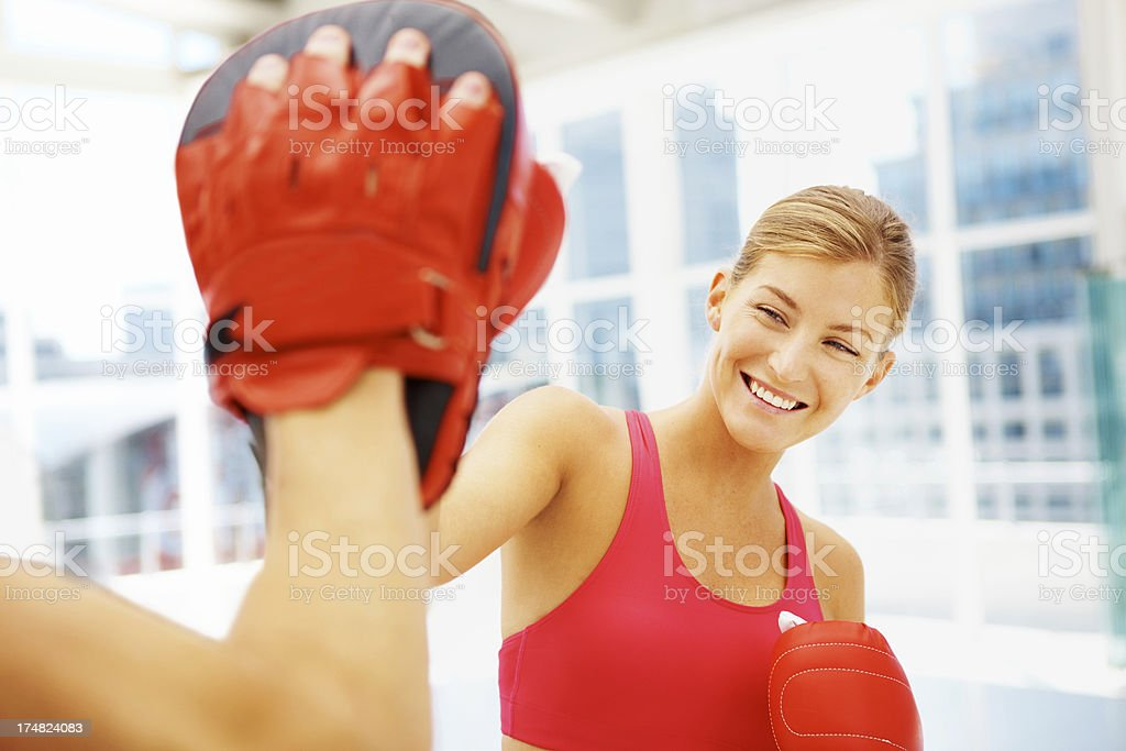 Sparring with her fitness trainer royalty-free stock photo