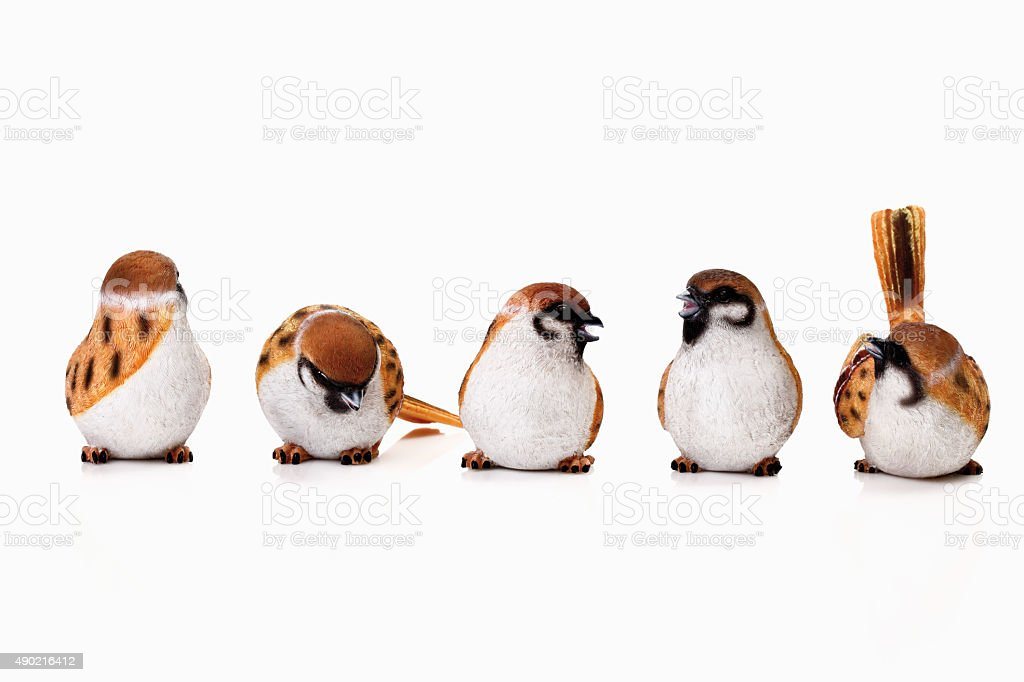 Sparrow figurine on white background stock photo