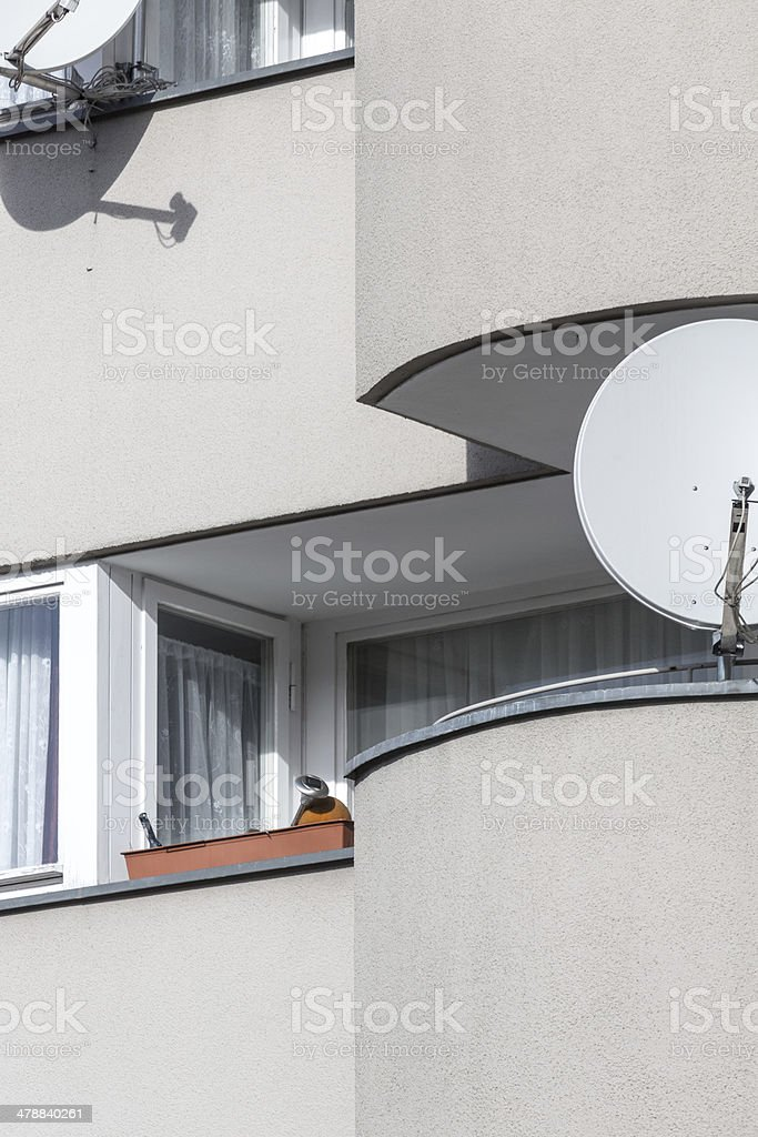 sparse balcony with satellite dishes shoot in berlin germany stock photo
