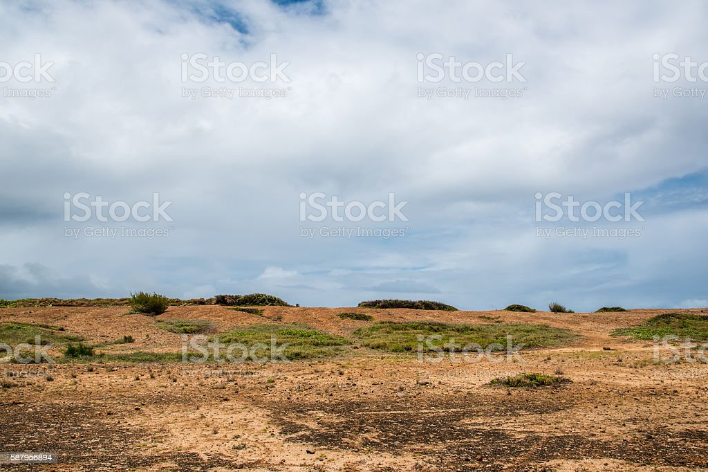 Sparse Hill Crest with Blue Sky stock photo