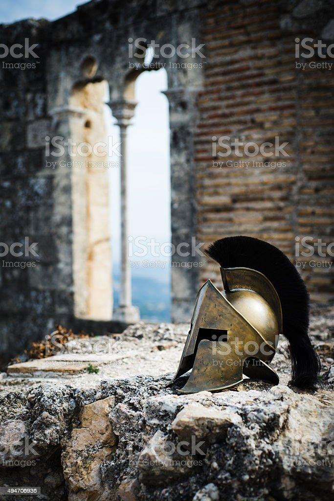 Spartan helmet on castle ruins. stock photo