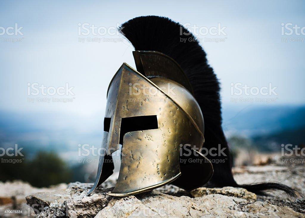 Spartan helmet on rocks. stock photo