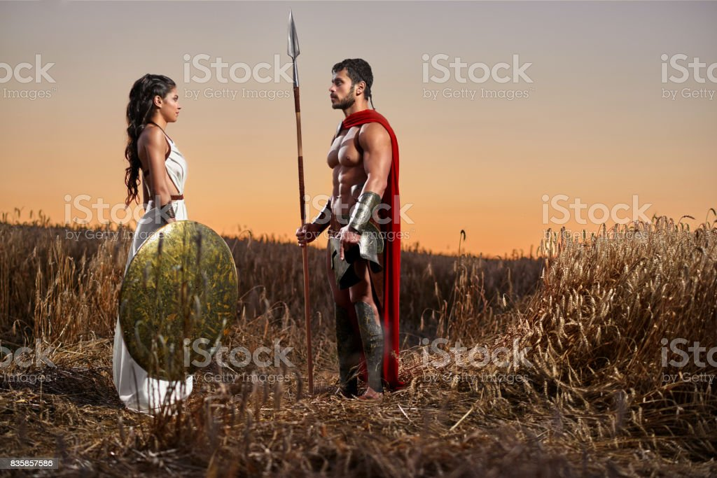 Spartan warrior and his woman in the field stock photo