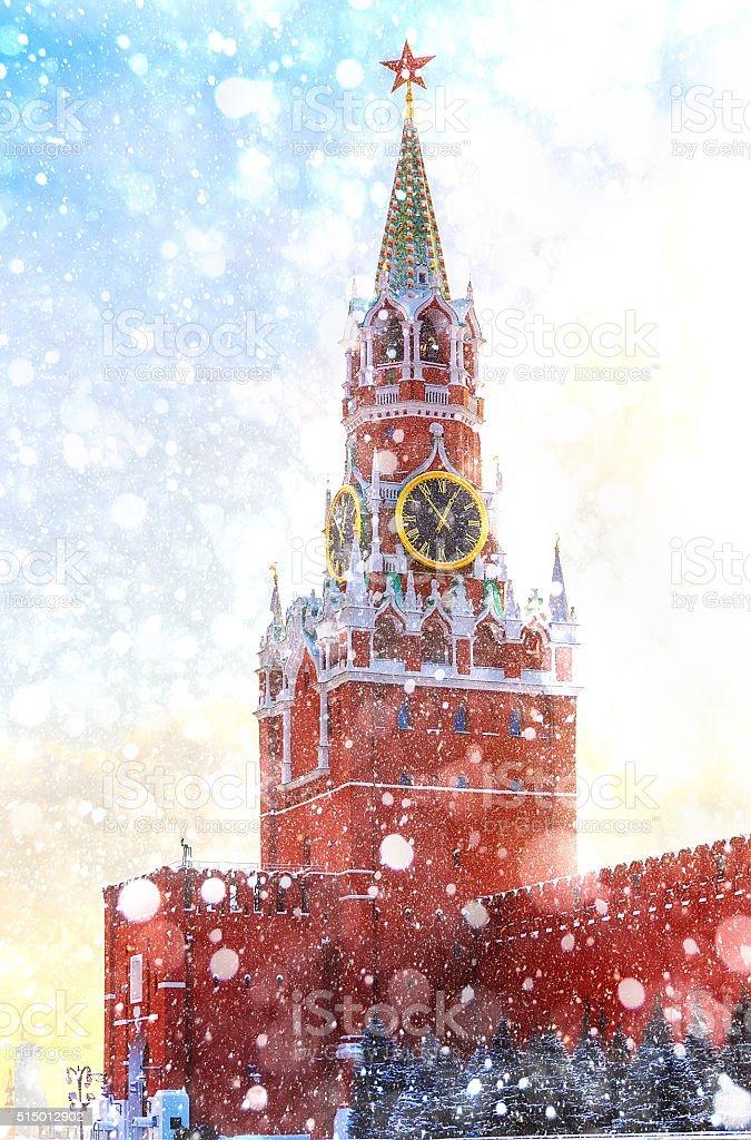 Spasskaya Tower Kremlin Moscow winter sunset Red Squaresnowfall stock photo
