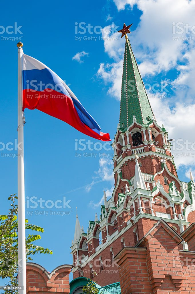 Spasskaya Tower of Kremlin and russian flag in Moscow stock photo