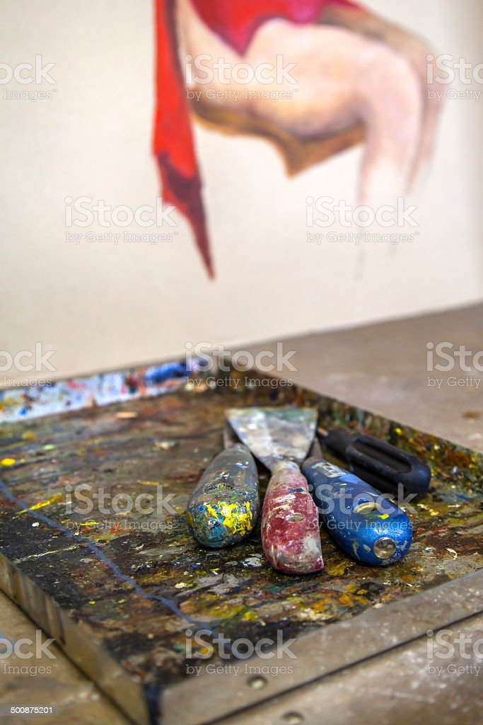 Spatulas used to paint covered with oil colors stock photo