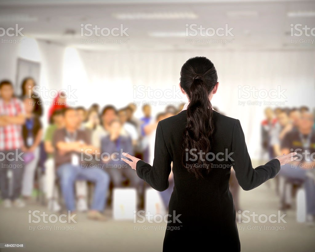 Speaker at conference and presentation stock photo