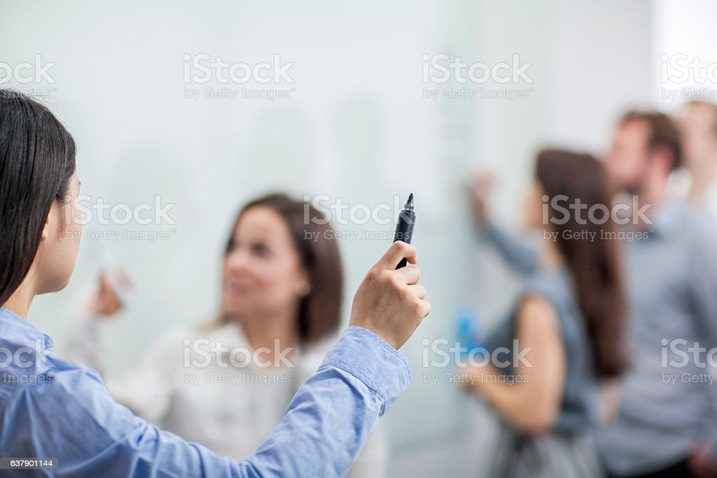 Speaker leading meeting in conference room stock photo