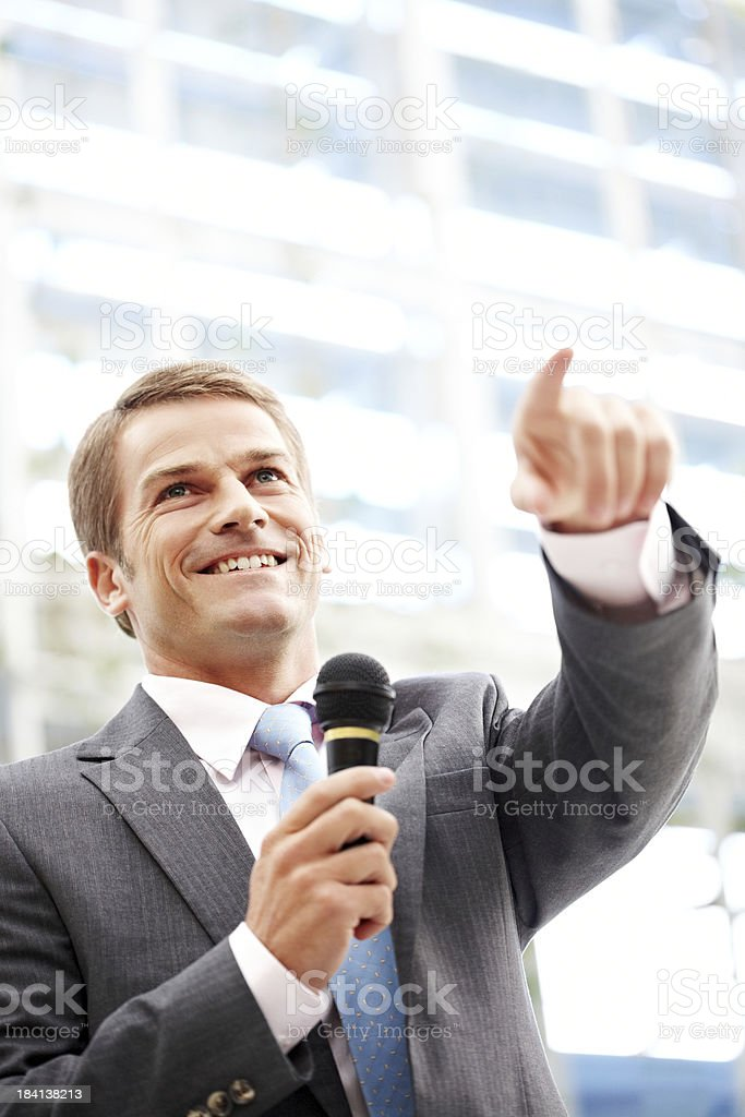 Speaker Pointing to Someone in the Audience royalty-free stock photo