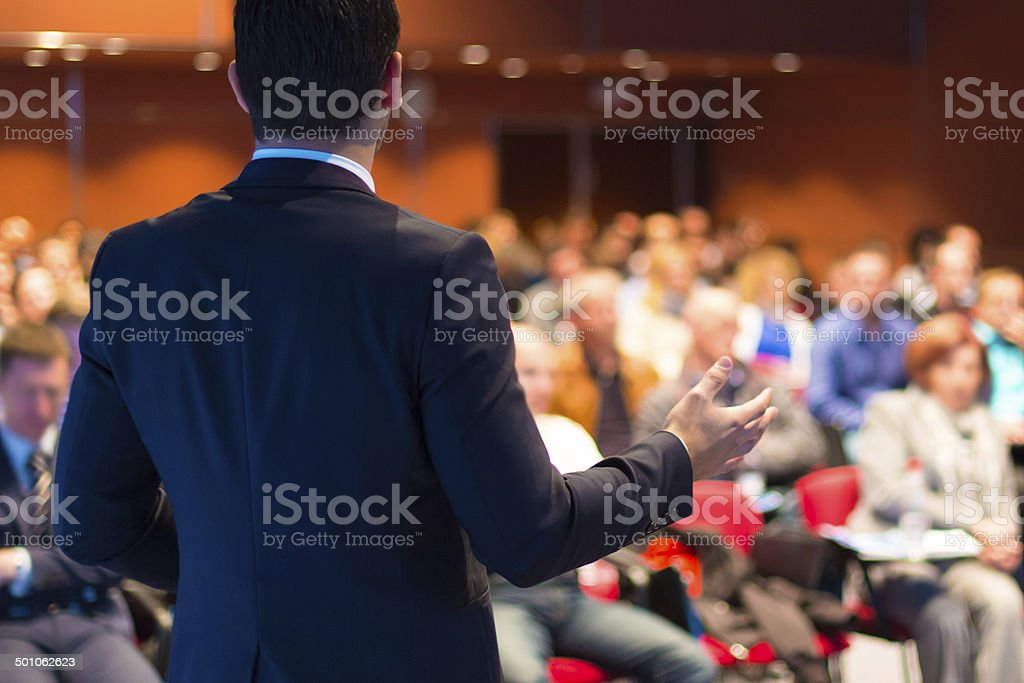Speaker presenting at business seminar stock photo