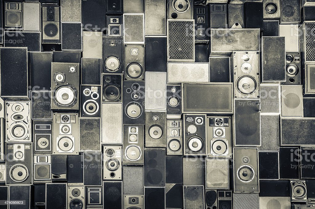 Speakers hanging on wall in monochrome style stock photo
