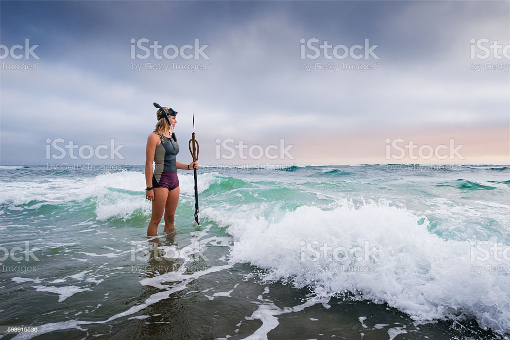 Spearfishing Women Standing In The Ocean stock photo