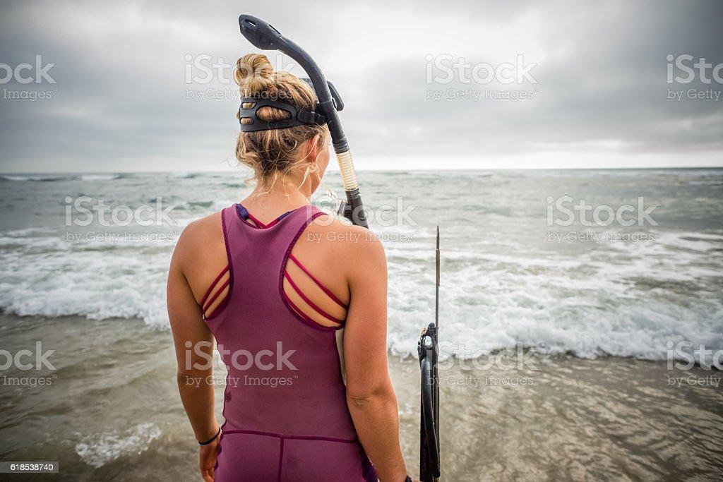 Spearfishing Women Standing In The Ocean stock photo