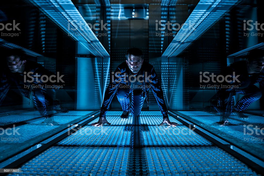 special agent crawling in a dark corridor stock photo