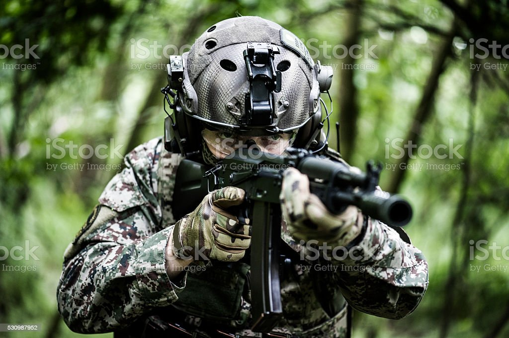 Special armed forces in woods stock photo