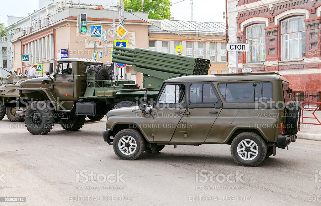Special armored vehicle UAZ-3152 Hussar and BM-21 Grad stock photo