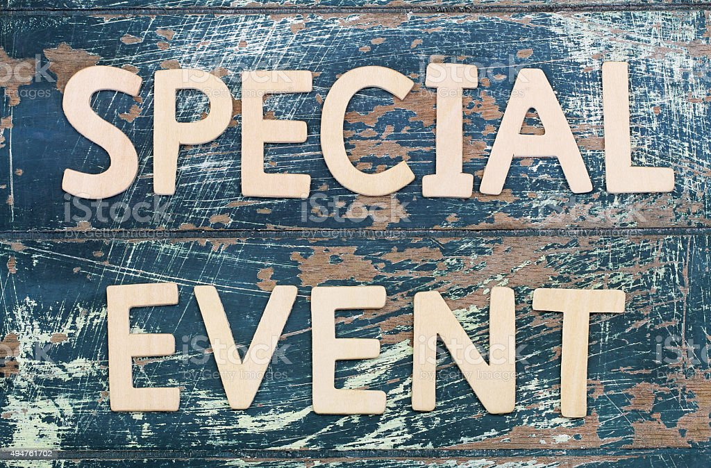 Special event written with wooden letters on rustic surface stock photo