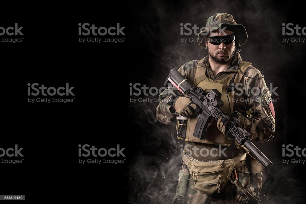 Special forces operator with rifle stock photo