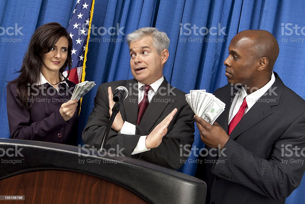Special Interest Groups Try To Bribe Politician royalty-free stock photo
