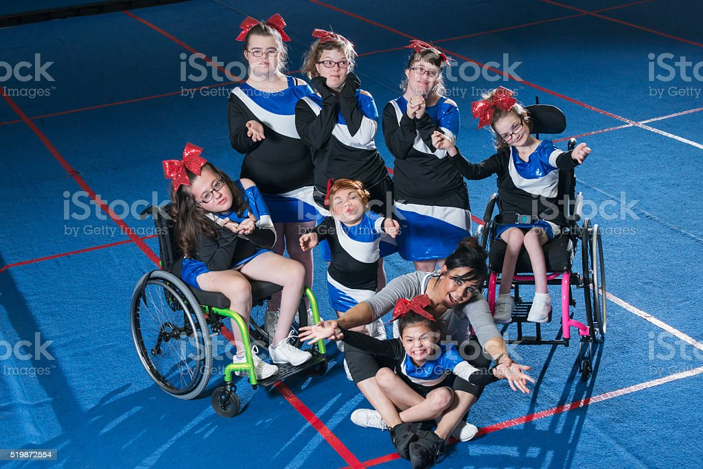 Special needs cheerleading team with coach stock photo