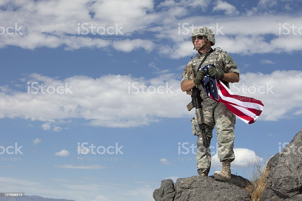 Special ops military soldier holding an american flag royalty-free stock photo
