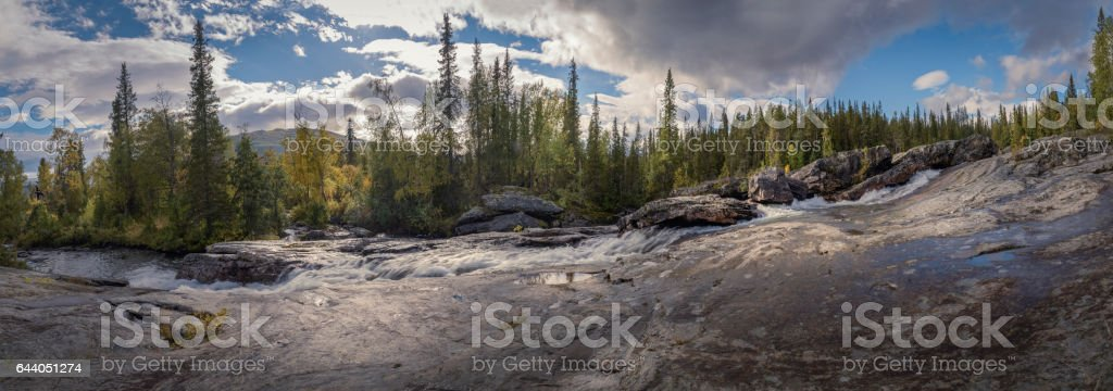 Special waterfall panorama surrounded by pine forest giving magical feel to the picture stock photo