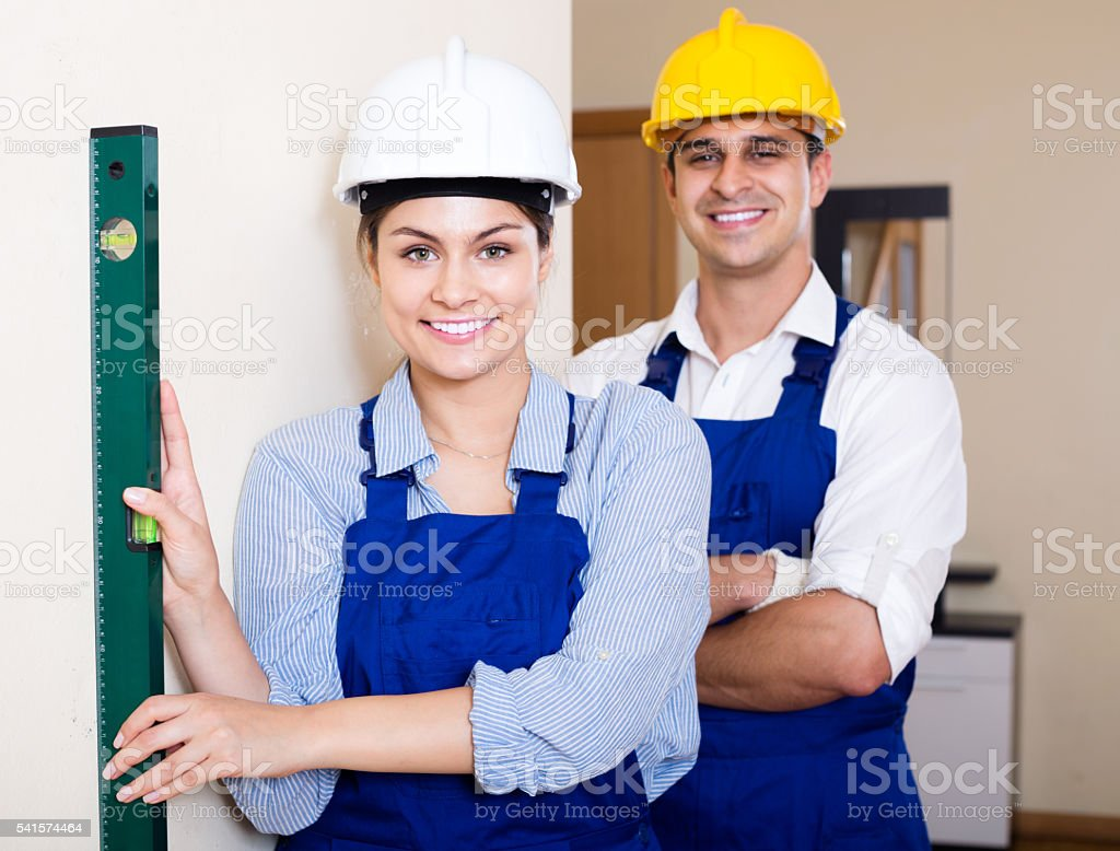 specialist and assistant working with wall in new building stock photo