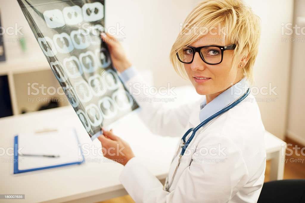 Specialist checking brain tomography results royalty-free stock photo