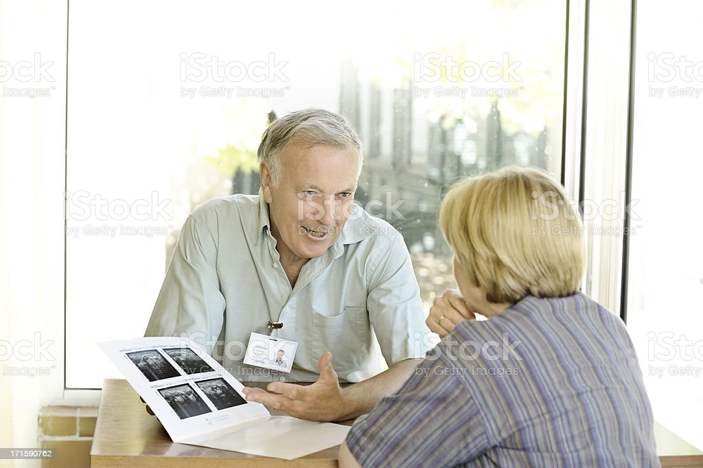 Specialist doctor explains scans to woman stock photo
