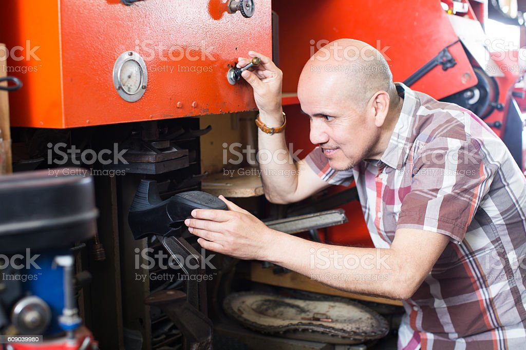 Specialist fixing heel taps stock photo