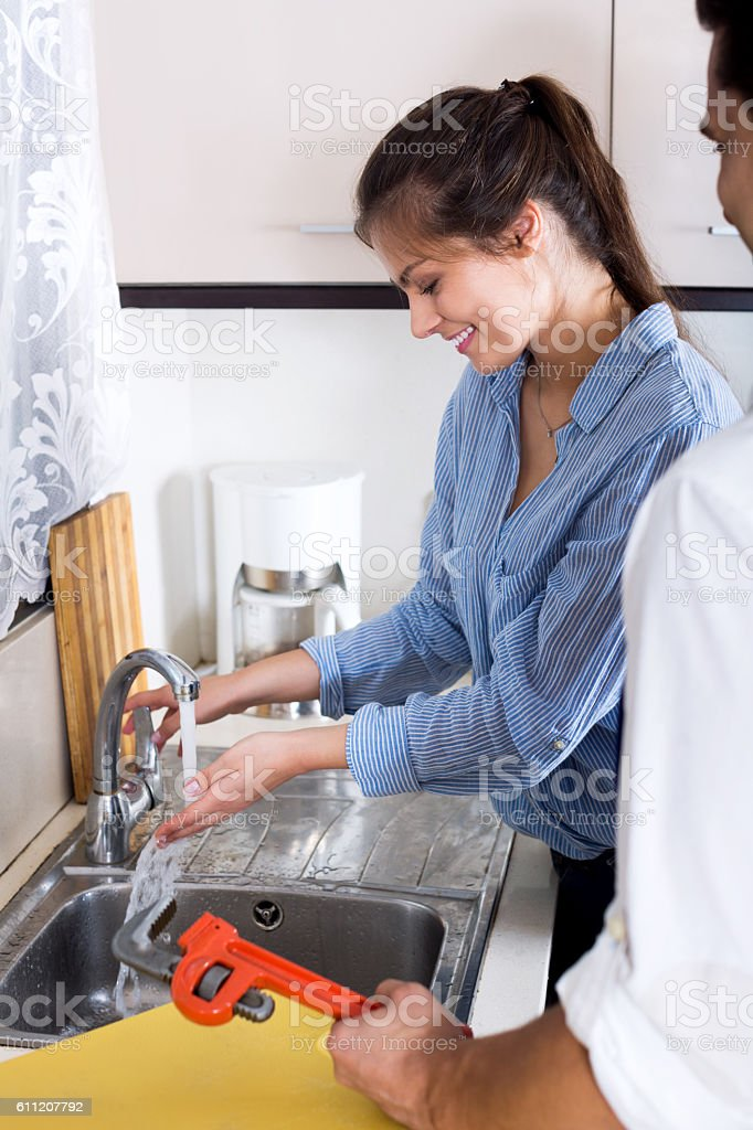 Specialist in uniform helping worried woman stock photo