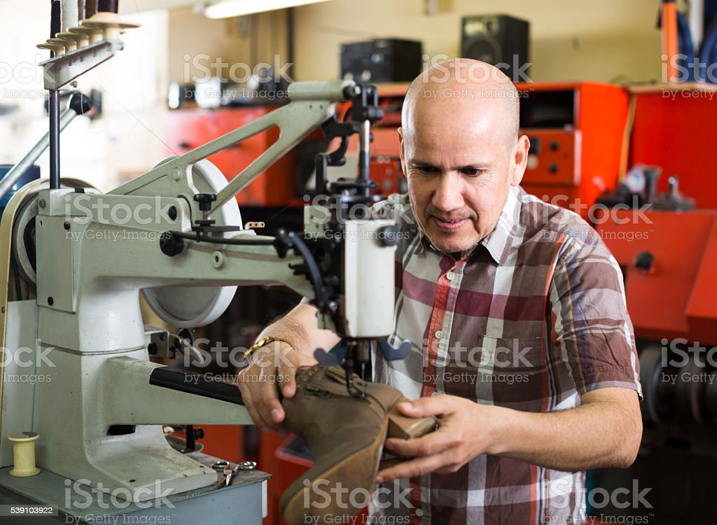 specialist stitching shoes stock photo
