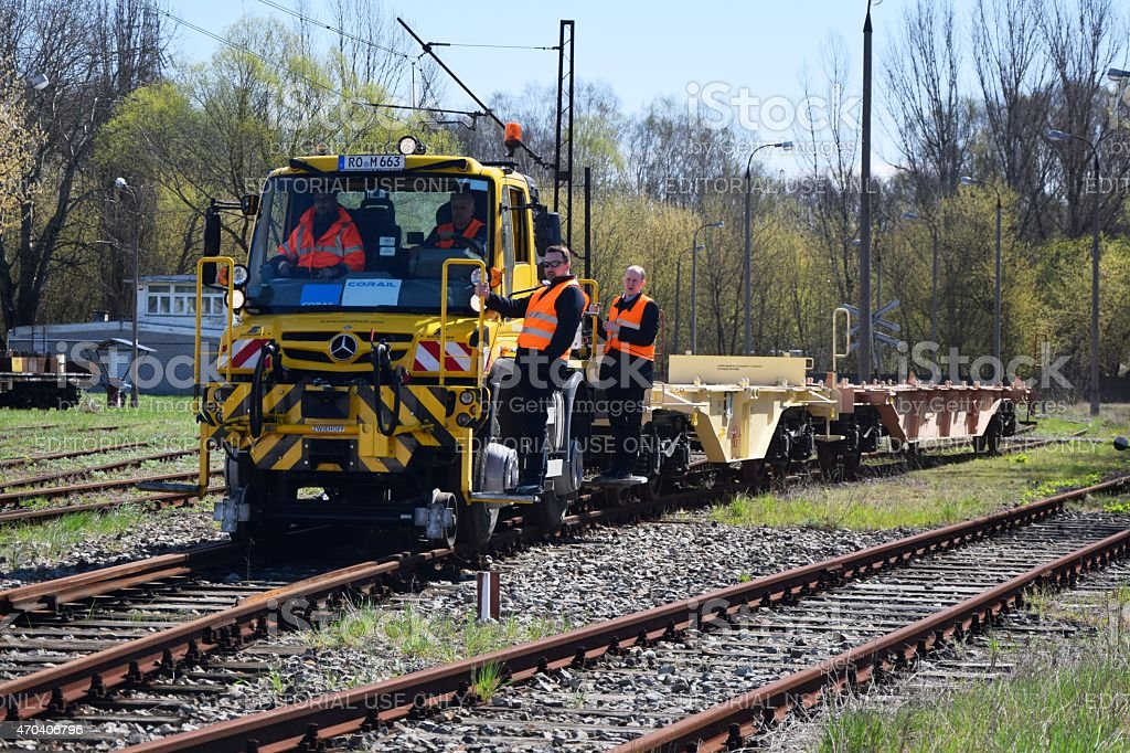 Specialized road/rail vehicle on rails in motion stock photo