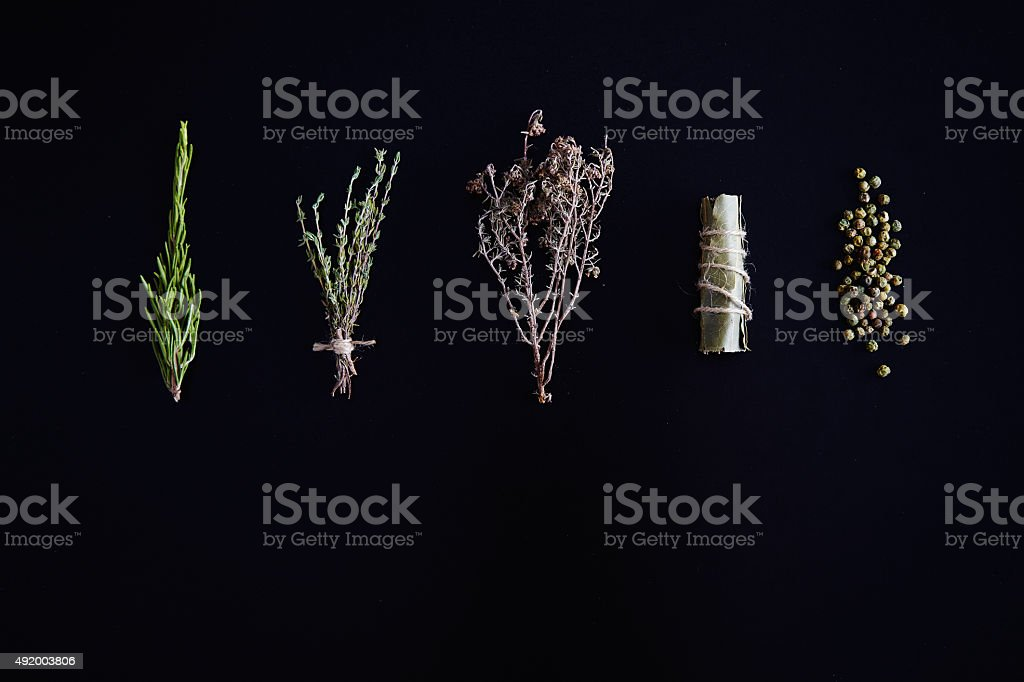 Species and herbs: rosemary majoran thyme and bay leaf isolated stock photo