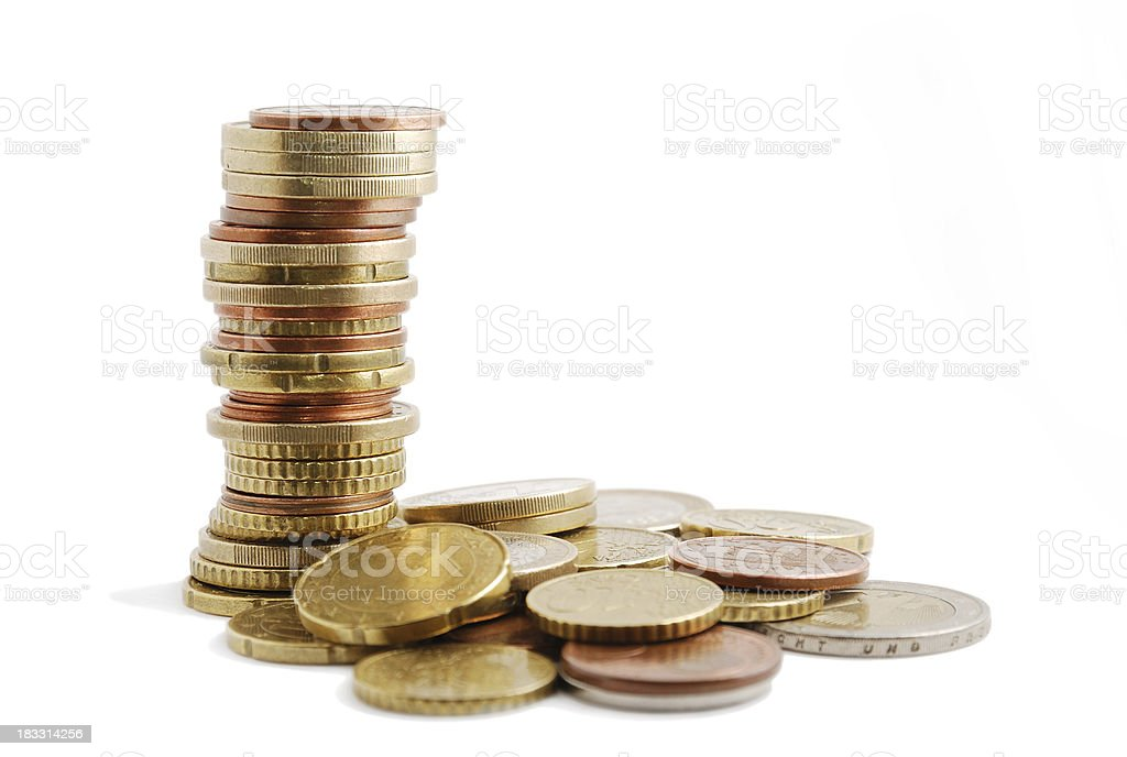 Specie's pile and tall column of coins near royalty-free stock photo