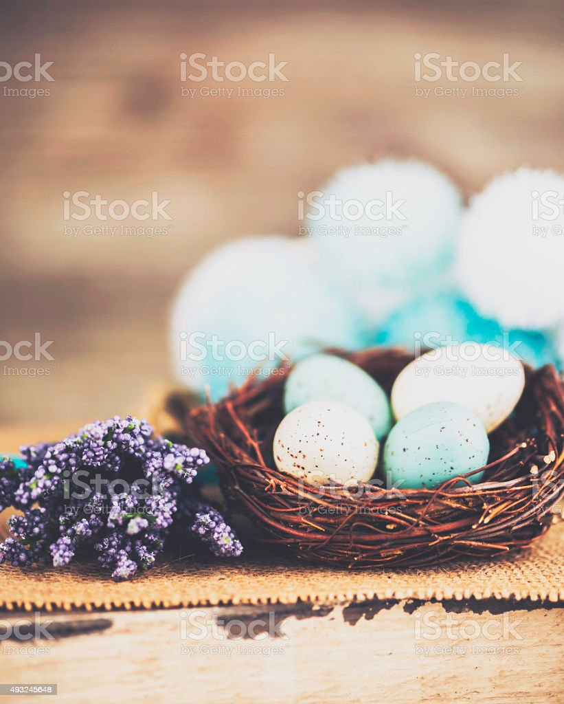 Speckled blue Easter eggs with flowers. Rustic Easter still life. stock photo