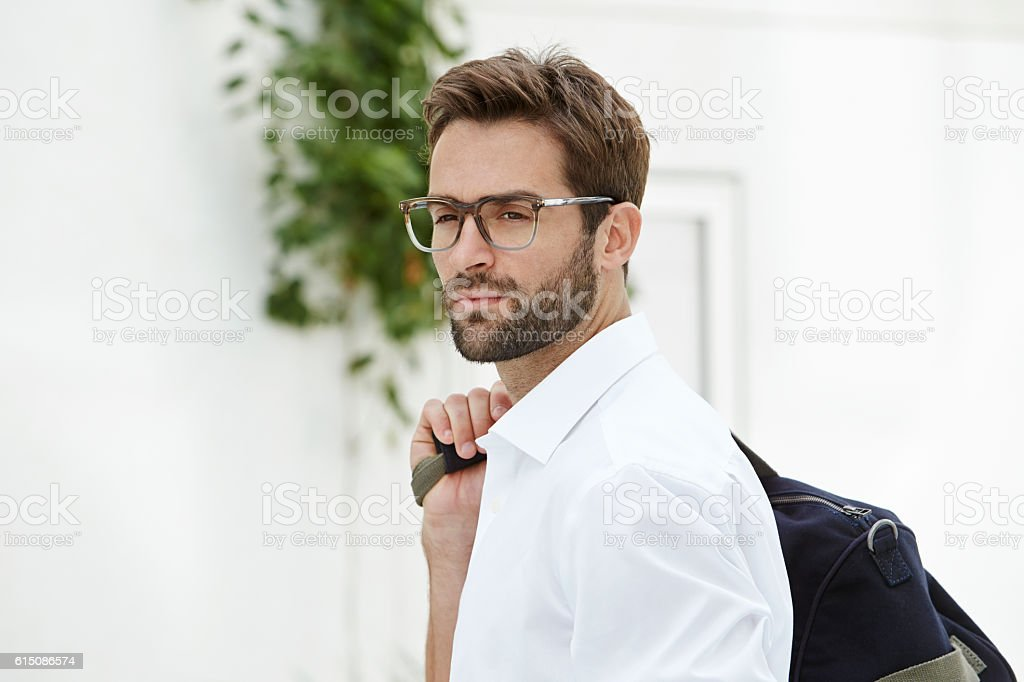 Spectacled man looking away stock photo