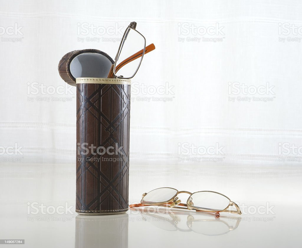 Spectacles and tube stock photo