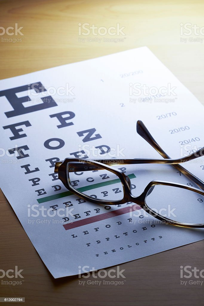 Spectacles with eye chart,blue tone stock photo