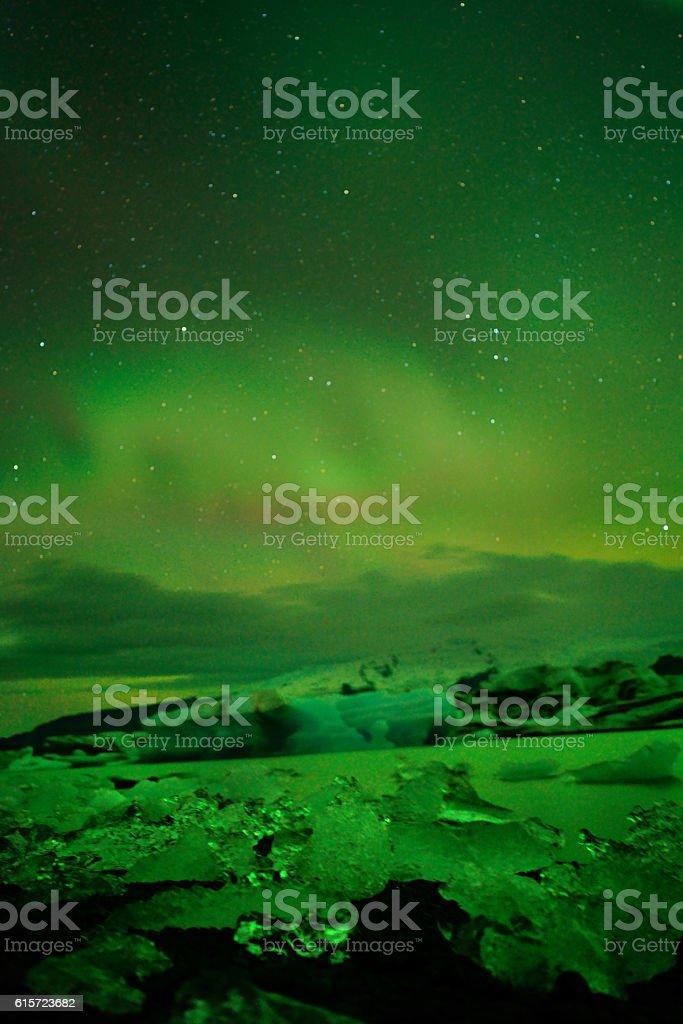Spectacular auroral display over the glacier lagoon Jokulsarlon in Iceland stock photo