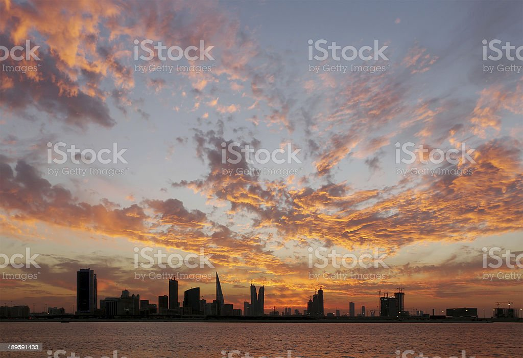 Spectacular clouds pattern during sunset, Bahrain skyline stock photo