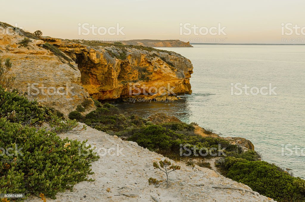 Spectacular coastal cliff bay at sunset high view stock photo