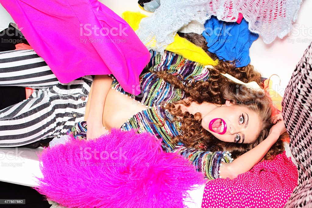 Spectacular girl in bath with clothes stock photo
