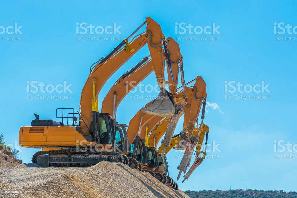 spectacular group of excavators stock photo