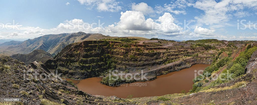 Spectacular landscape view of Negwenya Iron Ore Mine and sky stock photo