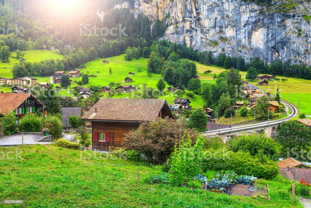 Spectacular Lauterbrunnen town with high cliffs, Bernese Oberland, Switzerland, Europe stock photo